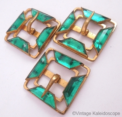 trio of vintage green vauxhall glass belt buckles