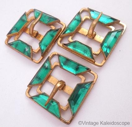trio of vintage green vauxhall glass belt buckles