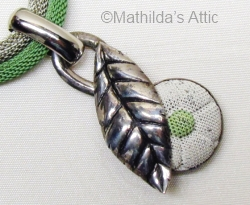 green and white enamel mesh flower and leaf