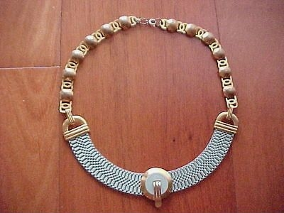 pale blue necklace with central disc