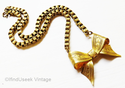 1930s brass bow necklace from IfindUseek Vintage on Etsy