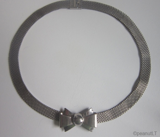 1930s art deco bow and silvertone metal choker