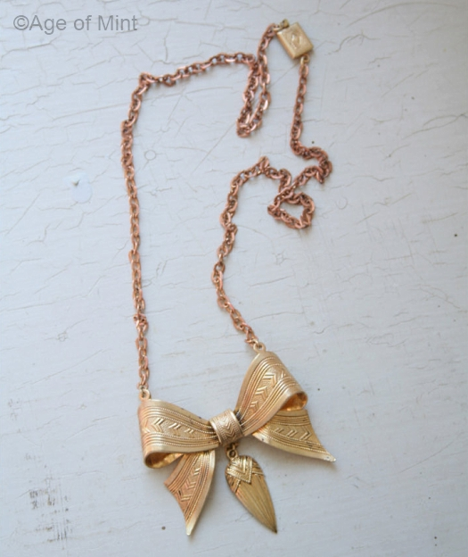 1930s brass bow necklace on coppertone chain at AGE OF MINT v1