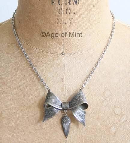 art deco silvertone bow necklace at AGE OF MINT