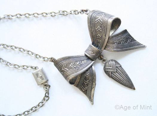 art deco silvertone bow necklace at AGE OF MINT view 2