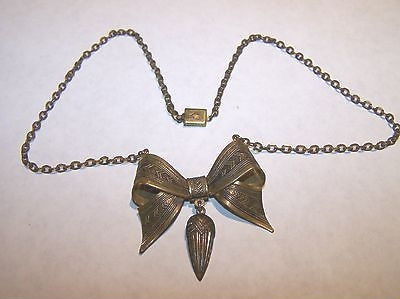 deco era brass bow necklace view 1