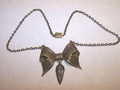 deco era brass bow necklace view 1