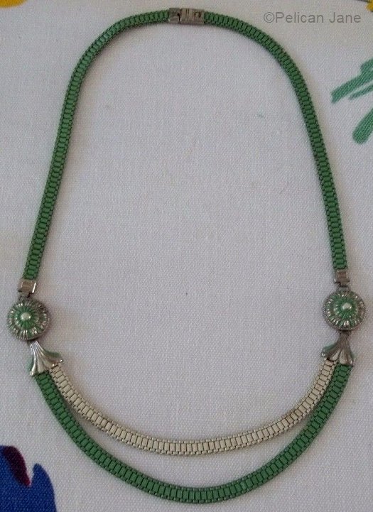 green and white double medallion necklace