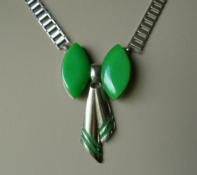 silvertone and green bakelite bow detail