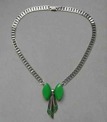 1930s silvertone ladder chain with green bakelite bow