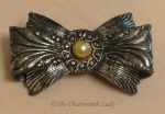 1930s bow brooch with faux pearl