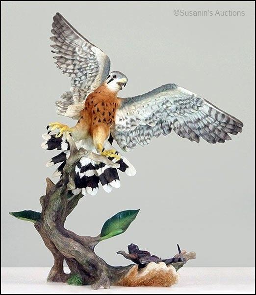 Boehm kestrel with lizard