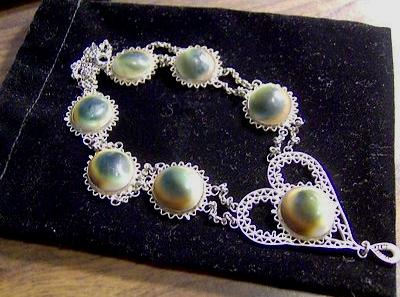 another operculum filigree heart necklace