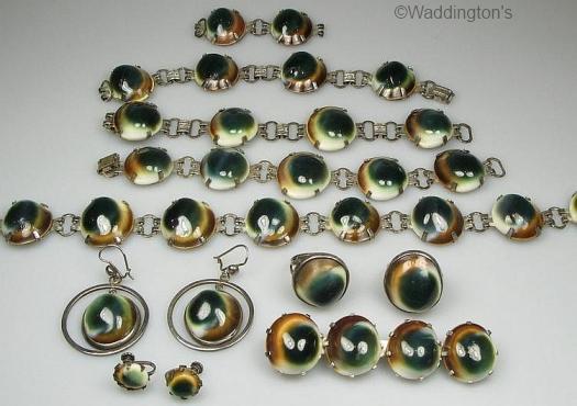 various vintage and modern operculum jewelry