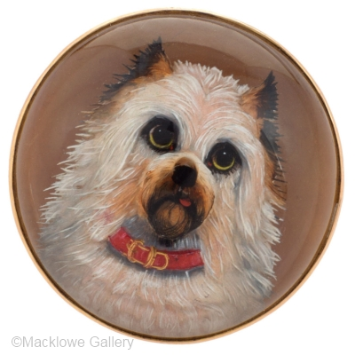 This dog portrait brooch is set in 15k gold.