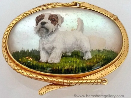 A Sealyham Terrier, in a 14k dog-collar design brooch.