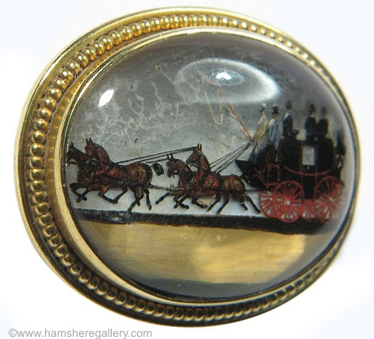 "This brooch depicts a coach and ""four-in-hand""."