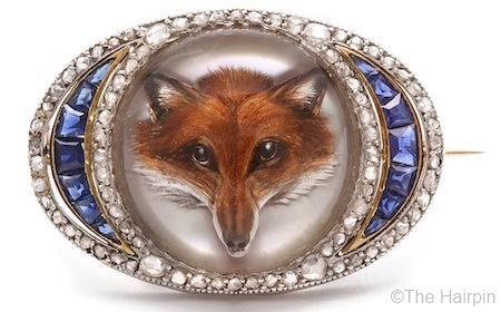 """This brooch is 1 1/2"""" wide and is lavishly set with diamonds and sapphires."""