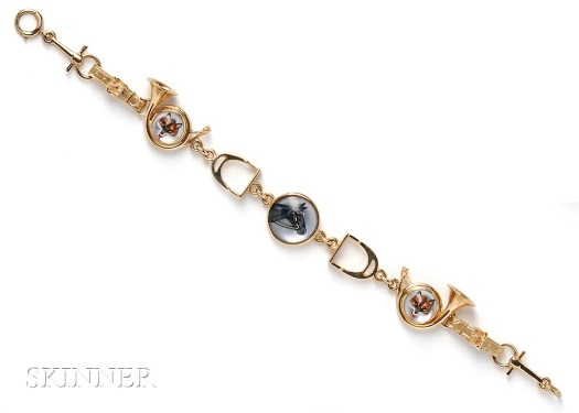 "14k gold bracelet with stirrup-form links; the fox crystals are set into hunting horns. Length 7""."