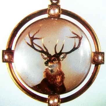 And lastly, a pearl-accented pendant depicting a majestic stag.