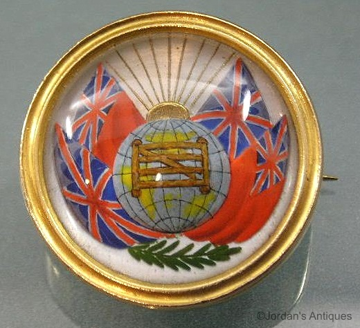 Essex crystal flags globe and fence brooch