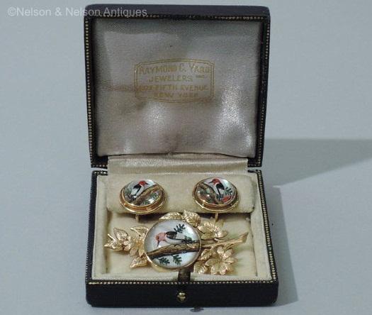 reverse carved crystal woodpecker brooch earrings set