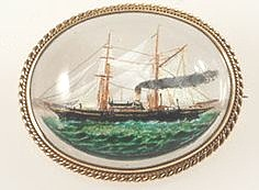 antique Essex crystal brooch of a steam yacht