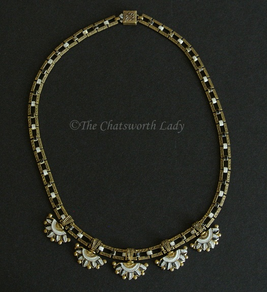black and white lotus flower necklace view 1