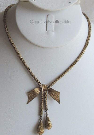 brass half bow snake chain lariat necklace 1930s