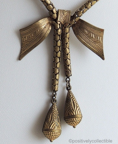 brass half bow snake chain necklace detail