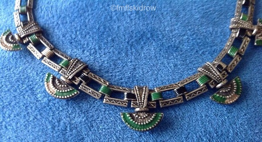 green and white fan necklace detail