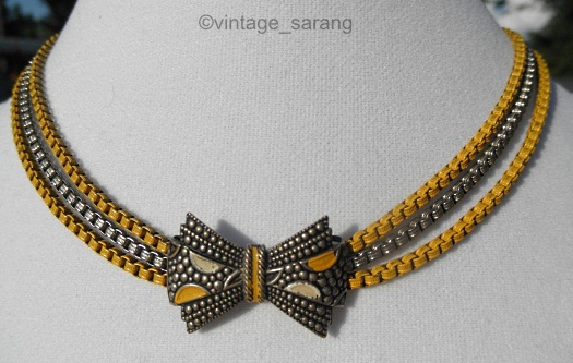 mustard yellow and silver art deco era bow necklace
