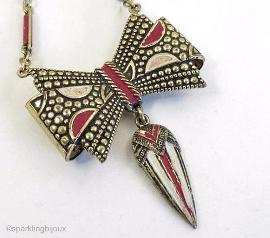 red and white enamel bow with drop detail